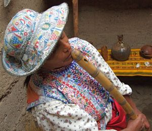 24 - Collaguas Woman Playing Traditional Flute, Colca Canyon, Peru