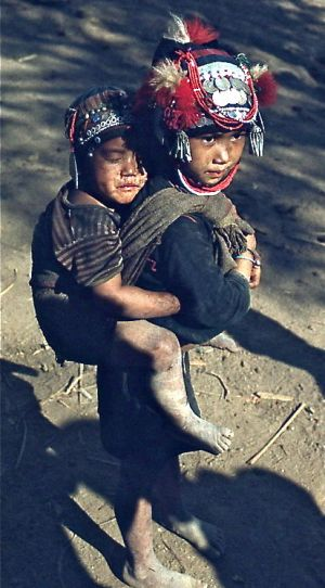 16 - Young Akha Girl With Sleeping Brother